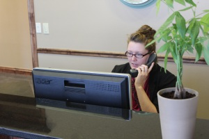 Anna at front desk